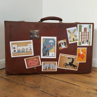 luggage stickers on a suitcase