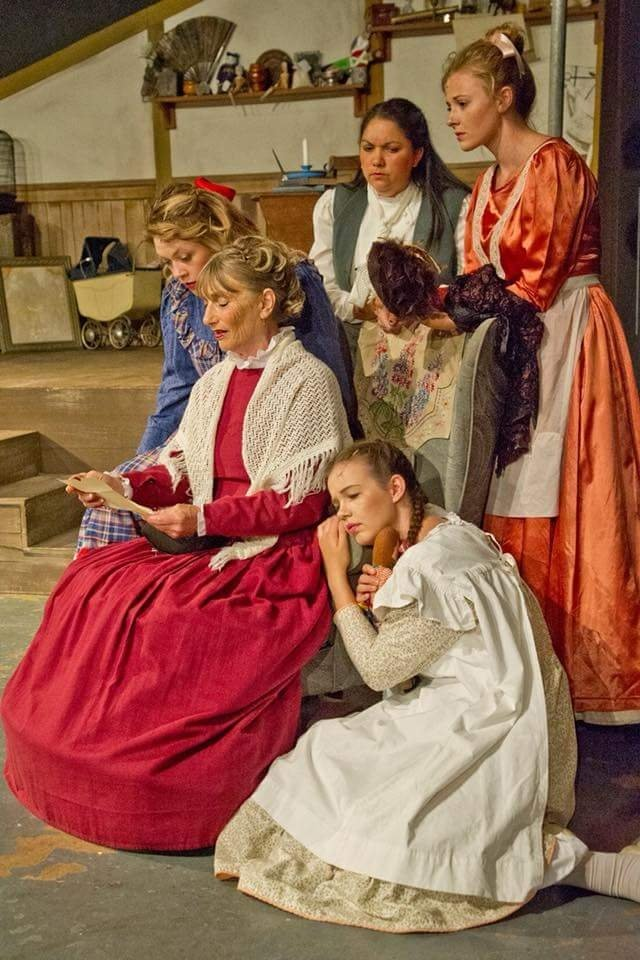 A beautiful photo of the sisters around Marmee in her chair in Little Women the musical at Epworth Hall. Photo John Martin