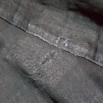 The holes in the jeans are almost invisible