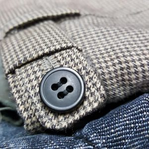 Sewing buttons on trousers